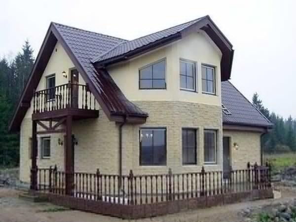 Отделка фасада у дома из бруса