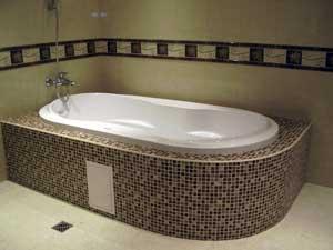 Отделка стен в ванной комнате кафелем