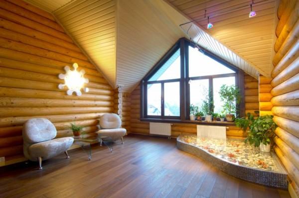 Дизайн интерьера зала в загородном доме при помощи блок-хоуса