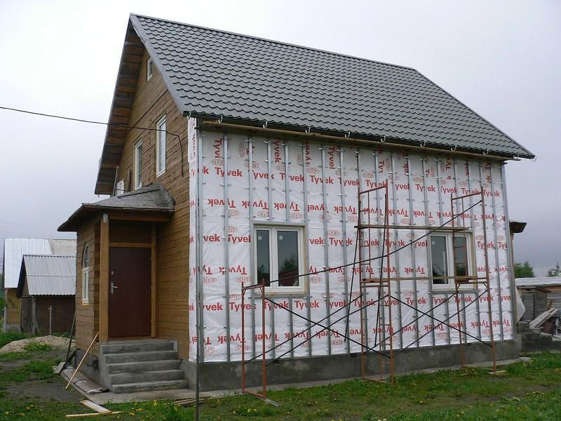 Фасад дома штукатурка и дерево