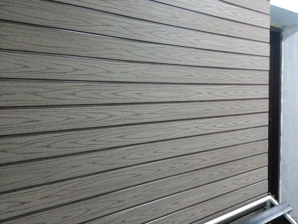 Фото фасада, облицованного сайдингом из ДПК