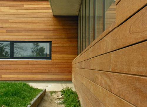 Облицовка дома деревянными панелями – традиционный вид наружной отделки
