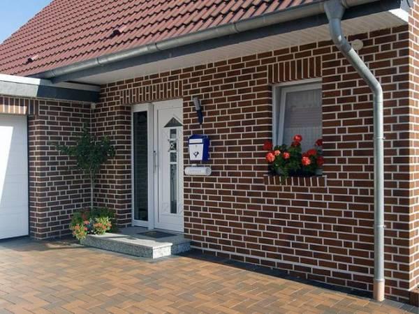 Облицовка фасада дома плиткой