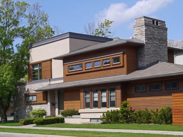 Планкен и сайдинговые панели под камень в дизайне фасада
