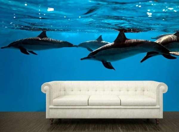 Дельфины в 3Д на фотообоях в интерьере гостиной
