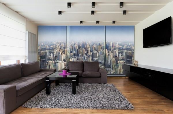 Панорамный вид на город в интерьере гостиной