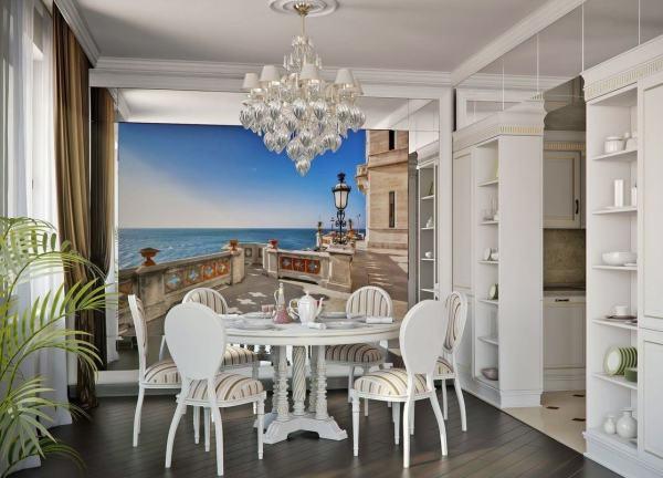 Вид с балкона на синее море в обеденной зоне кухни