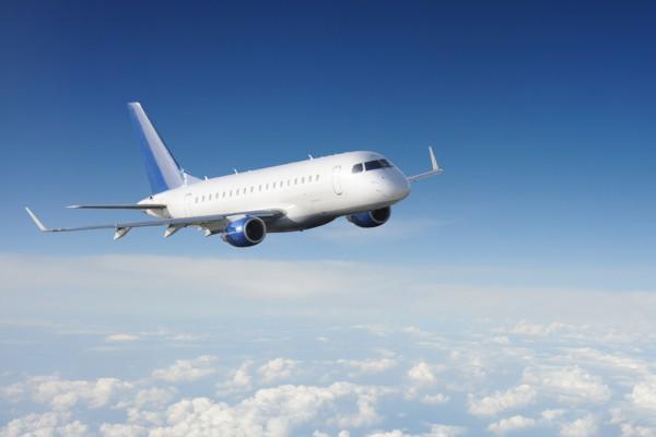 Фотообои с парящим над облаками самолётом