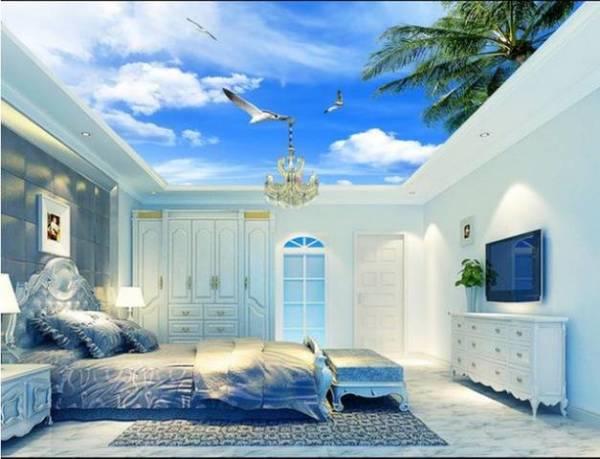 Фотообои с изображением неба хорошо подходят для оклеивания потолка