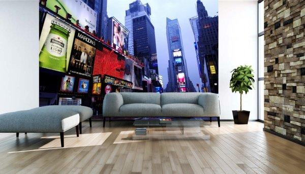 Изображение с видом снизу на небоскрёбы, создаёт ощущение, что вы находитесь посреди улицы в центре Нью-Йорка
