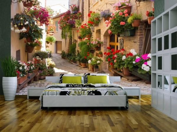 Фотообои с изображением красочного уличного садика в интерьере спальни