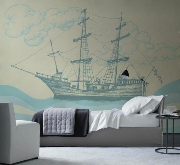 Фотообои с изображением нарисованного корабля в интерьере молодого парня