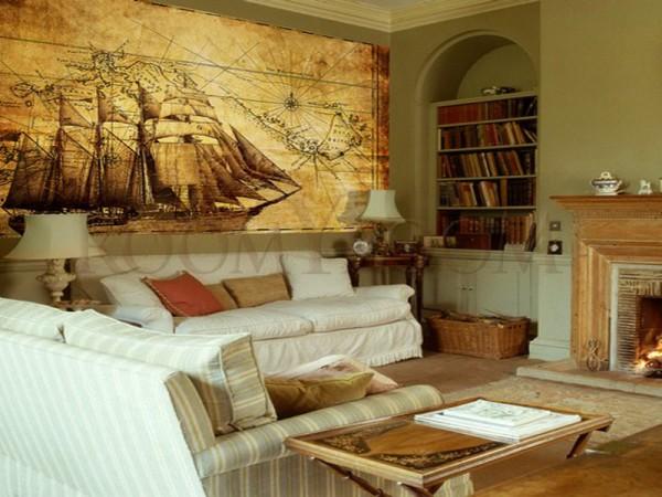 На фото, фотообои с изображением старой карты и старинного корабля в интерьере гостиной