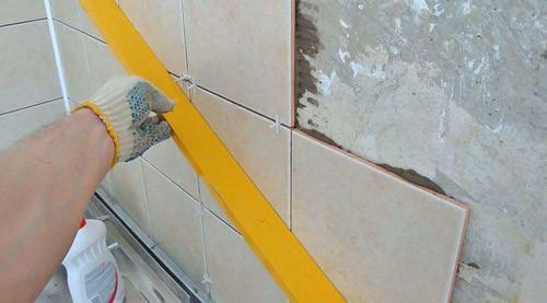 Укладка кафеля на стену из гвл