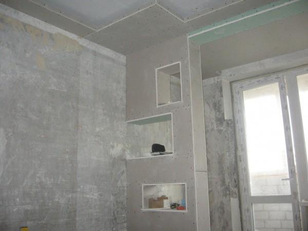 С помощью гипсокартона очень просто сооружать перегородки для зонирования помещения с дополнительными местами хранения