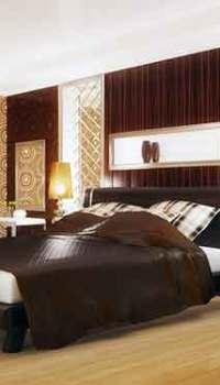 Большая спальня станет уютнее с оттенками коричневого