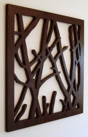 Деревянные панно с вырезанными необычными узорами станут достойным украшением любой стены