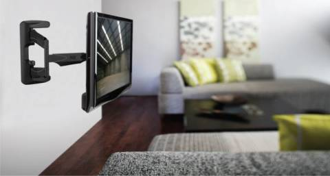 Телевизор на стене экономит пространство комнаты
